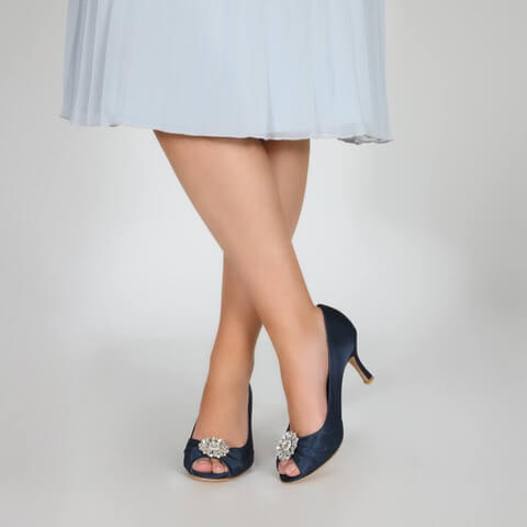Perfect Bridal satin navy occasion shoe with peep-toe. Has a pleated toe area with a dazzling floral crystal brooch