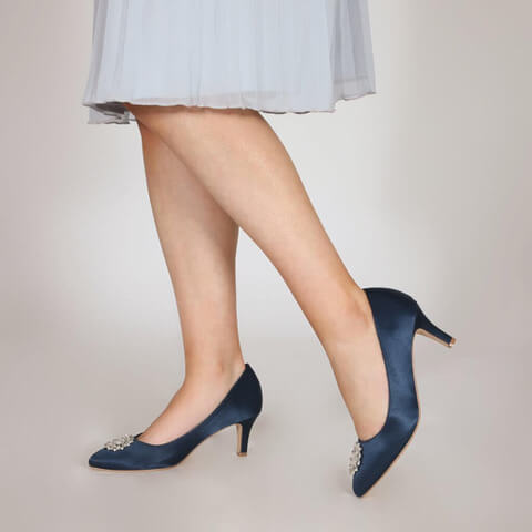 Perfect Bridal navy mid high heel court shoes featuring an almond toe and an eye catching crystal flower brooch