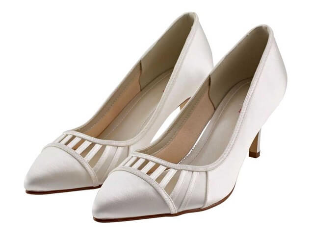 Rainbow Club Danni ivory satin wedding shoes. They have a softly-rounded pointed toe, a slender mid-height heel and satin overlay detail with peak-a-boo cut-out strips across the front