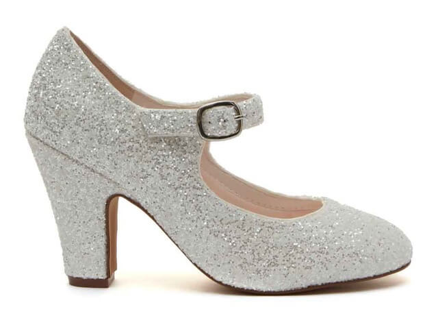 Rainbow Club Madeline ivory snow glitter bridal shoe. Features a chic almond toe, a comfortable but shapely block heel and an ankle strap with stylish silver buckle