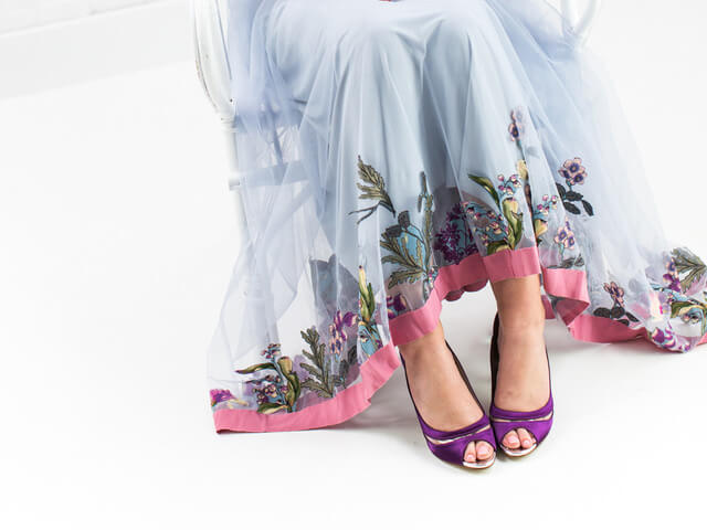 Rainbow Club Eloisa bridal shoes dyed purple. They have a peep toe, a high stiletto heel and chic vinyl detail which curves around the foot