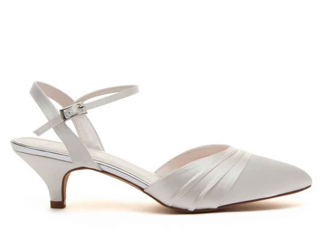Rainbow Club Julie ivory satin bridal shoe. Is a sling back shoe with an almond toe and stylish kitten heel