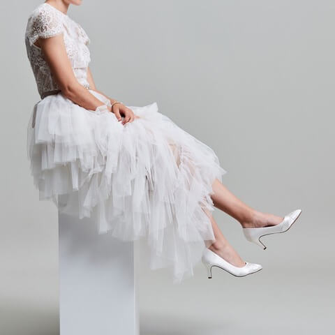 Rainbow Club Lexi ivory satin bridal shoe. Featuring an almond toe, chic low heel and crossover detail to the front