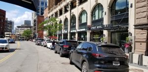 The Albert, upscale apartments, and local shops