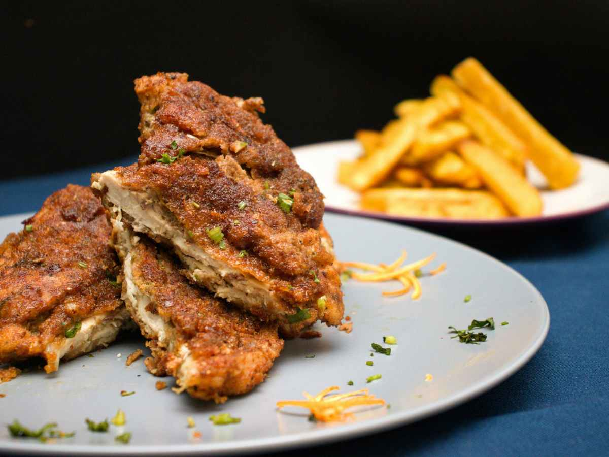 plates with deep fried meat and french fries