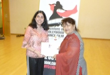 Getting the Certificate - Roopa and Saroj Khan