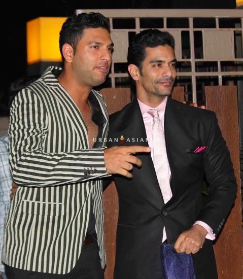 Indian cricketer Yuvraj Singh and Angad Bedi