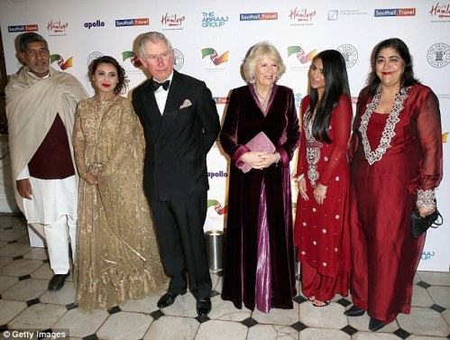 Prince Charles and Camilla (centre) pose with (left to right) Preeya Kalidas, Kailash Satyarthi, actress Rani Mukerji, Sair Khan, Gurinder Chadha and James Caan