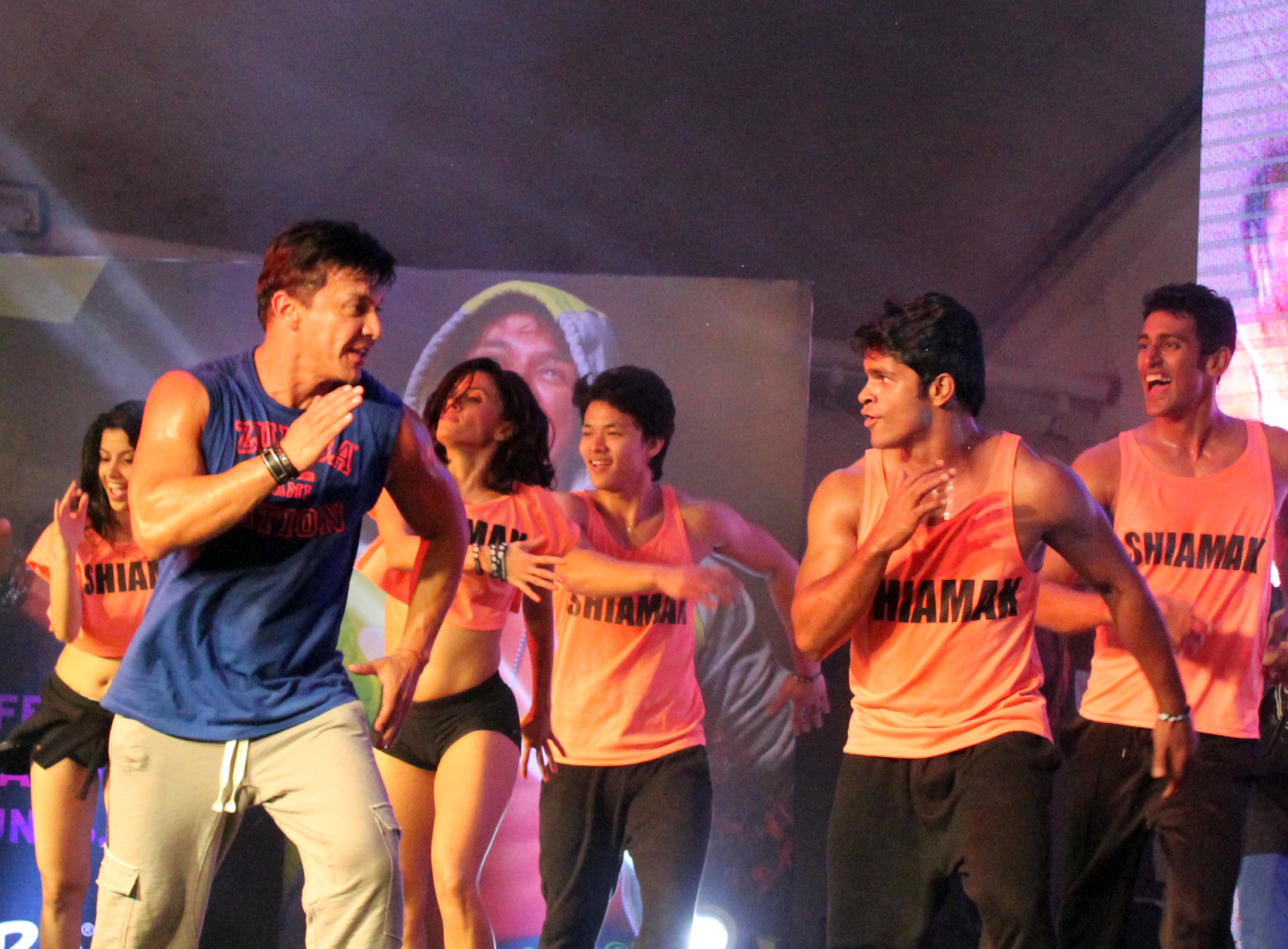 Beto Perez with SHIAMAK instructors leading a song at the Zumba party