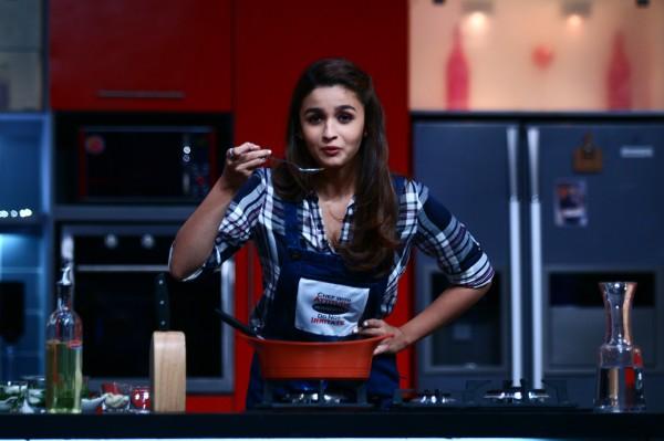 Alia tastes her cooking