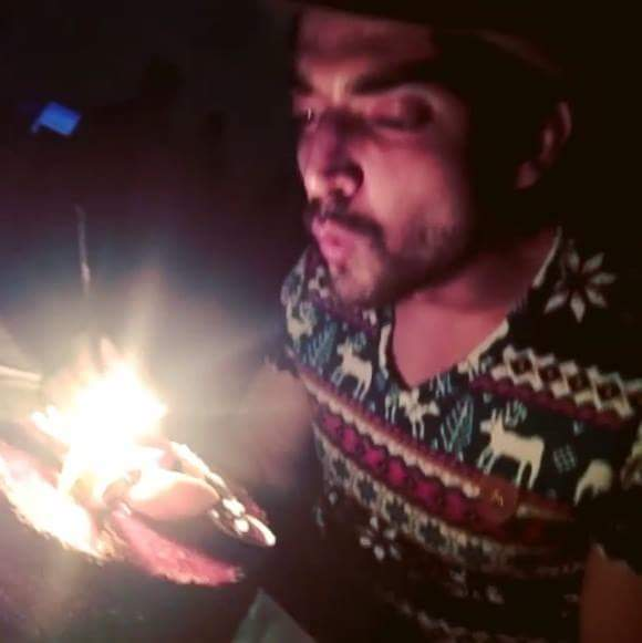 Gurmeet blowing out his birthday candles