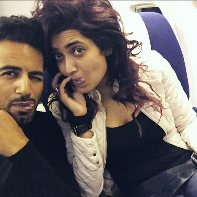 Upen and Karishma mixing business with pleasure
