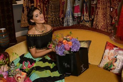 Nargis Fakri with Neill Strain Floral Couture bouquet