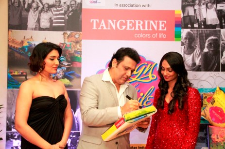 Govinda signs for a CSR initative by Tangerine to donate bedsheets to oldage homes