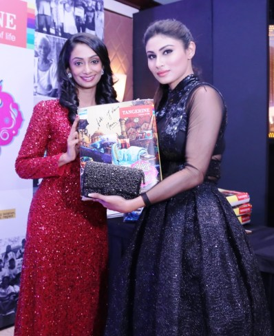 Mouni Roy signs for a CSR initative by Tangerine to donate bedsheets to oldage homes