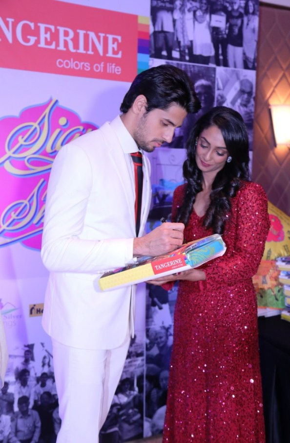 Siddharth Malhotra signs for a CSR initative by Tangerine to donate bedsheets to oldage homes