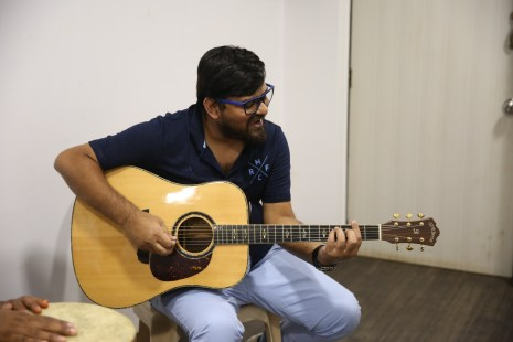 wajid khan playing the guitar