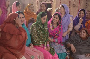 Kapil's mother Janak Rani in a Grey Shawl