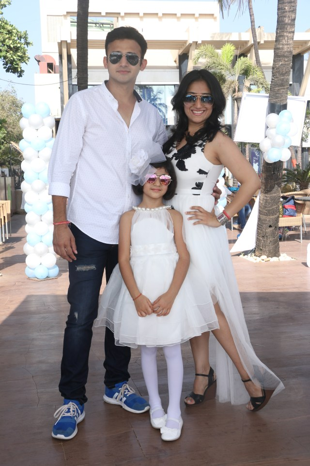 Romit Raj poses with wife and daughter