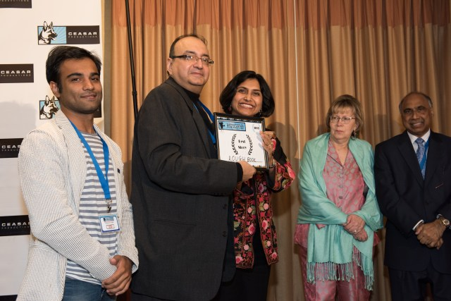 - Punit Ruparel and Viveck Vaswani recieving the award for best story for the film 'Roughbook' at DC South Asian Film Festiv