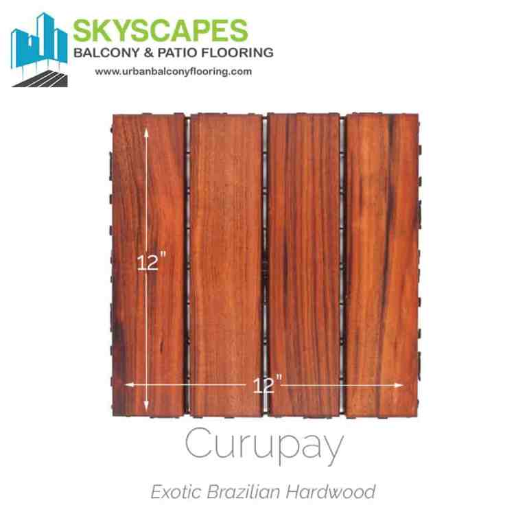 Heavy-duty hardwood four-slat outdoor flooring tile. Face-on view of Curupay wood showing rich, natural wood grain on a slight amber hued deck tile.