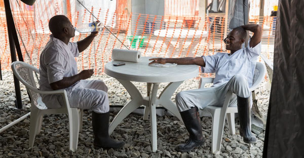 Workers at an Ebola treatment center relax Jan. 10, 2015 in Tubmanburg, Liberia. The facility was built by the U.S. military. (Whitney Leaming/The Washington Post)
