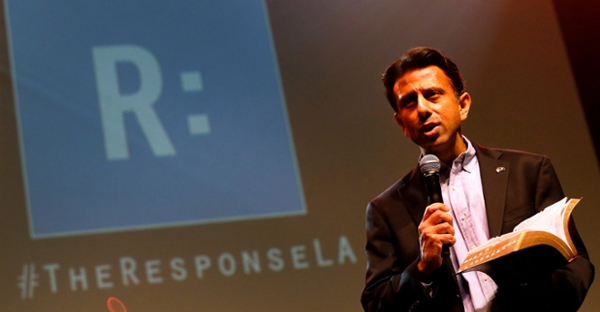 Louisiana governor Bobby Jindal reads from the Bible during a prayer rally in Baton Rouge. (Jonathan Bachman/AP)