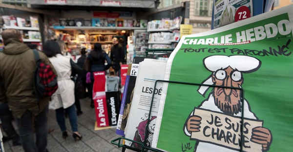 People queue for the new issue of satirical French weekly Charlie Hebdo at a kiosk in Nice. (REUTERS)