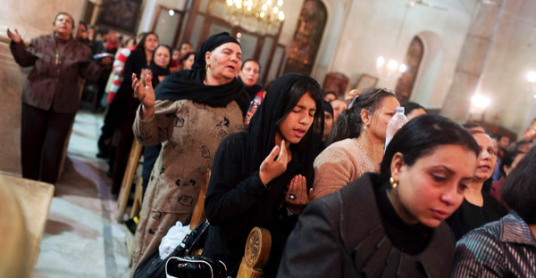 Coptic Orthodox Christian pray during a religious session by father Makary at St Mark Cathedral in Cairo. (Reuters)