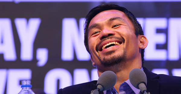 Manny Pacquiao of the Philippines speaks to media at the post fight press conference after winning against Chris Algieri of the United States during the WBO world welterweight title at The Venetian on November 23, 2014 in Macau, Macau. (Chris Hyde/Getty Images AsiaPac)