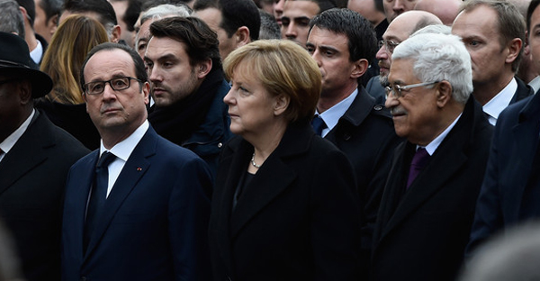 (L-R) Francois Hollande, Angela Merkel and Mahmoud Abbas walk during a mass unity rally following the recent terrorist attacks on January 11, 2015 in Paris, France. (Pascal Le Segretain/Getty Images Europe)