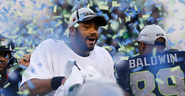 Quarterback Russell Wilson #3 of the Seattle Seahawks celebrates following the 2015 NFC Championship game against the Green Bay Packers at CenturyLink Field on January 18, 2015 in Seattle, Washington. (Christian Petersen/Getty Images North America)