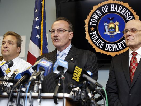 Harrison police Chief Anthony Marraccini, center, joined by Mayor Ron Belmont, right, gives a news conference Monday, Feb. 23, 2015, on the suicide of retired White Plains officer and the killing of his two daughters on Saturday, Feb. 21, 2015 at Harrison police headquarters. (Photo: Tania Savayan, The (Westchester County, N.Y.) Journal News)