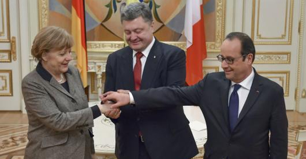 Ukraine's President Petro Poroshenko (C) shakes hands with German Chancellor Angela Merkel and French President Francois Hollande during their meeting in Kiev, February 5, 2015. (REUTERS/UKRAINIAN PRESIDENTIAL PRESS SERVICE/MIKHAIL PALINCHAK/HANDOUT VIA REUTERS)