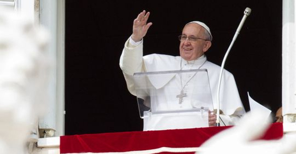 Pope Francis waves to people from his studio window overlooking St. Peter's Square during the Angelus noon prayer at the Vatican on Feb. 22. (Riccardo De Luca, AP)