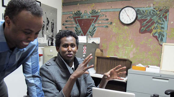 Mohamed Farah, left, executive director of Ka Joog, talks with Vice President Daud Mohamed in Minneapolis. U.S. Attorney Andy Luger will lead a delegation of local law enforcement and Somali community leaders, including Farah, to a meeting in Washington. (AP)