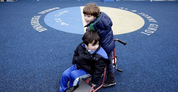 Leo Jajati, 4, right, and Michael Skaba, 4, play on the rooftop playground at the Al & Sonny Gindi Barkai Yeshivah in Brooklyn, New York, Wednesday, March 11, 2015. (AP Photo/Seth Wenig)