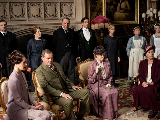 """The """"Downton Abbey"""" cast gathers for a scene in Season 5. The show is ending after Season 6. (Photo: Nick Briggs, Carnival Films for Masterpiece)"""