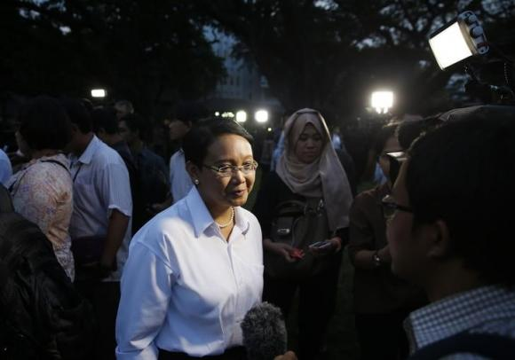 Marsudi, Indonesia's current ambassador to the Netherlands, speaks to the media after she was named the country's next foreign minister, in Jakarta