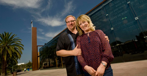 Rick and Kay Warren stand in front of the Saddleback Church Worship Center. Their church has grown into a global ministry. (PAUL RODRIGUEZ)