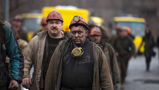 Miners walk out of the Zasyadko coal mine