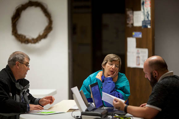 A woman choosing a health plan in Iowa, one of the states where subsidies could be eliminated by a Supreme Court ruling. (Credit: Andrew Dickinson for The New York Times)