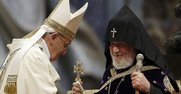 Pope Francis, left, is greeted by the head of Armenia's Orthodox Church, Karekin II, during an Armenian-Rite Mass in St. Peter's Basilica at the Vatican on April 12. (Gregorio Borgia/AP)