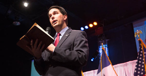 Gov. Scott Walker of Wisconsin, at the Iowa Faith & Freedom Coalition Spring Kick-Off, attends a theologically strict church. (Scott Morgan for The New York Times)