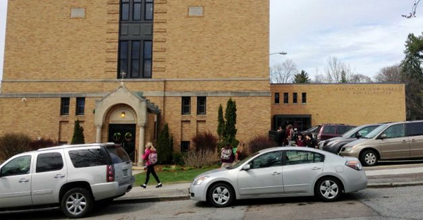 In this April 29, 2015 photo, parents pick up their children at the end of the school day at Christ the King School in Burlington, Vt. (AP Photo/Lisa Rathke)