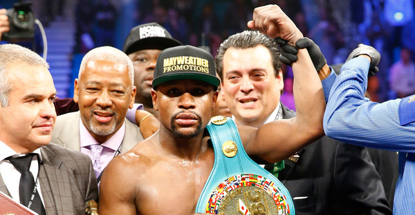 Floyd Mayweather Jr. celebrates the unanimous decision victory against Manny Pacquiao in their welterweight unification championship bout on May 2, 2015 at MGM Grand Garden Arena in Las Vegas, Nevada. (Al Bello/Getty Images North America)