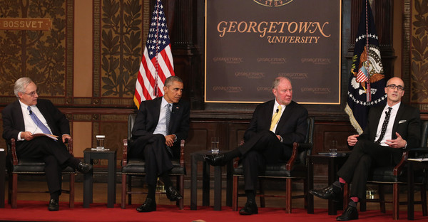 US President Barack Obama (2ndL) participates in a discussion on poverty with (L-R) moderator E.J. Dionne, Jr., Robert Putman Professor at Harvard University, and Arthur Brooks President of the American Enterprise Institute at the Catholic-Evangelical Leadership Summit, at Georgetown University May 12, 2015 in Washington, DC. (Mark Wilson/Getty Images North America)