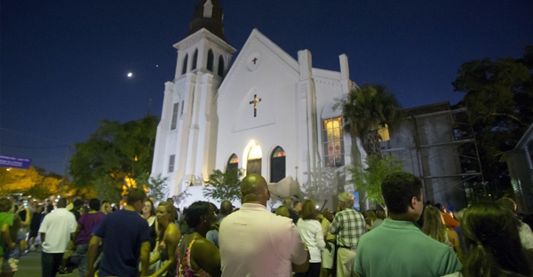 Mourners held a vigil outside Emanuel African Methodist Episcopal Church in Charleston, South Carolina, in memory of the nine people shot during a Bible study on Wednesday evening. (Reuters)