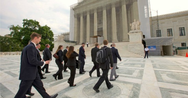 Law students visiting from Liberty University arrive at the Supreme Court. The students are with Liberty Counsel, a non-profit public interest law firm and ministry. (AP Photo/J. Scott Applewhite)