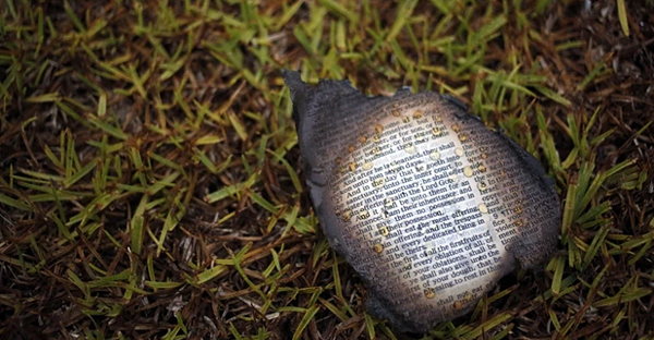 A charred Bible page outside Mount Zion African Methodist Episcopal church on Wednesday in Greeleyville, South Carolina. (Veasey Conway/AP)